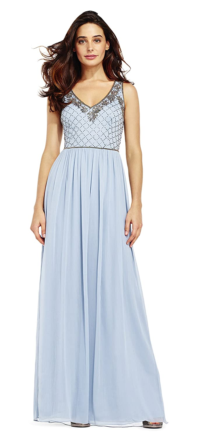 5468923a32f552 Features a v-neckline, sleeveless bodice, and a flowing chiffon skirt.  Beaded floral blooms and delicate beading along the neckline and waist; ...