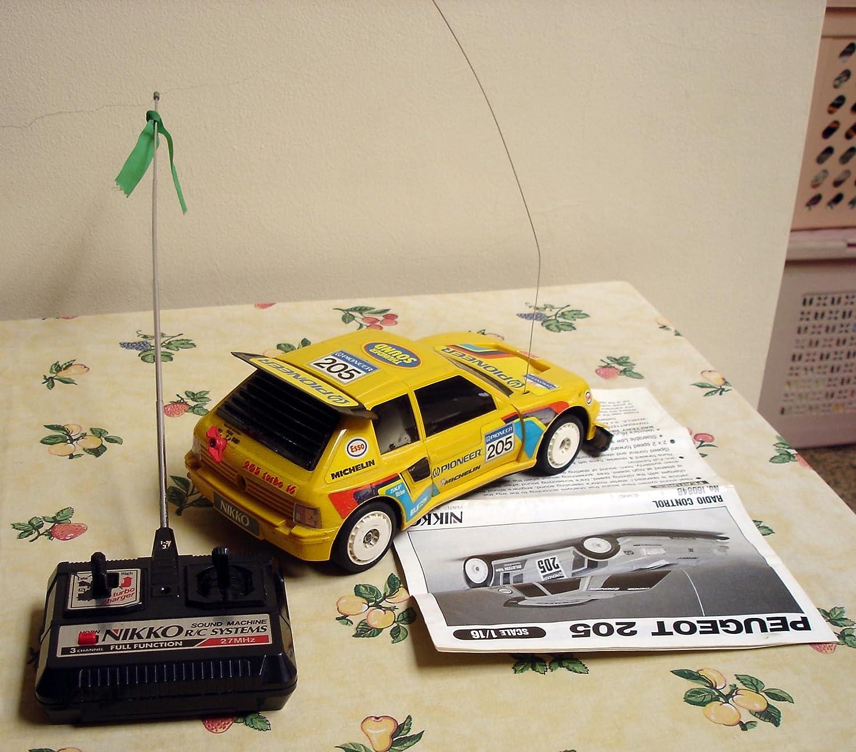 Amazon.com: Peugeot 205 Nikko RC Radio Remote Control Scale 1/16: Toys & Games