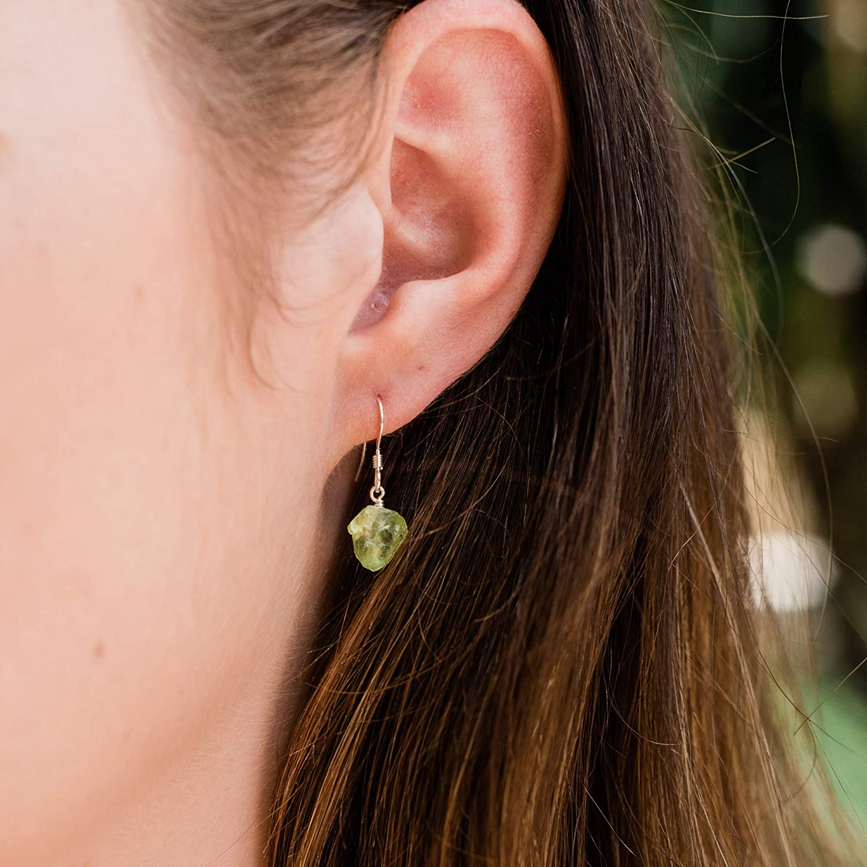 Raw peridot crystal dangle earrings in 925 sterling silver August birthstone