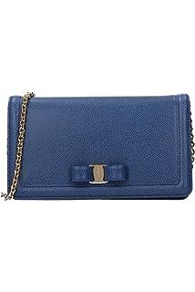 3dfaac00f0 Salvatore Ferragamo women s leather clutch with shoulder strap ...