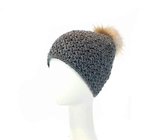 87f7886ff14 surell Handmade Starfish Knit Hat with Faux Fur Pom - Winter Ski Cap  (Black) at Amazon Women s Clothing store
