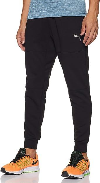 PUMA Energy Trackster Pantalones, Hombre: Amazon.es: Ropa y ...