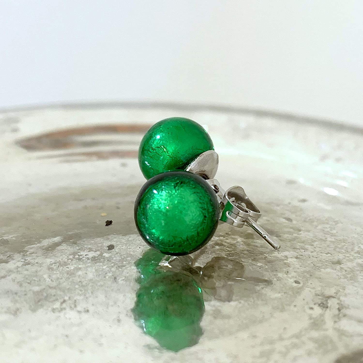 Diana Ingram earrings with dark green round emerald studs on surgical steel posts Murano glass sphere