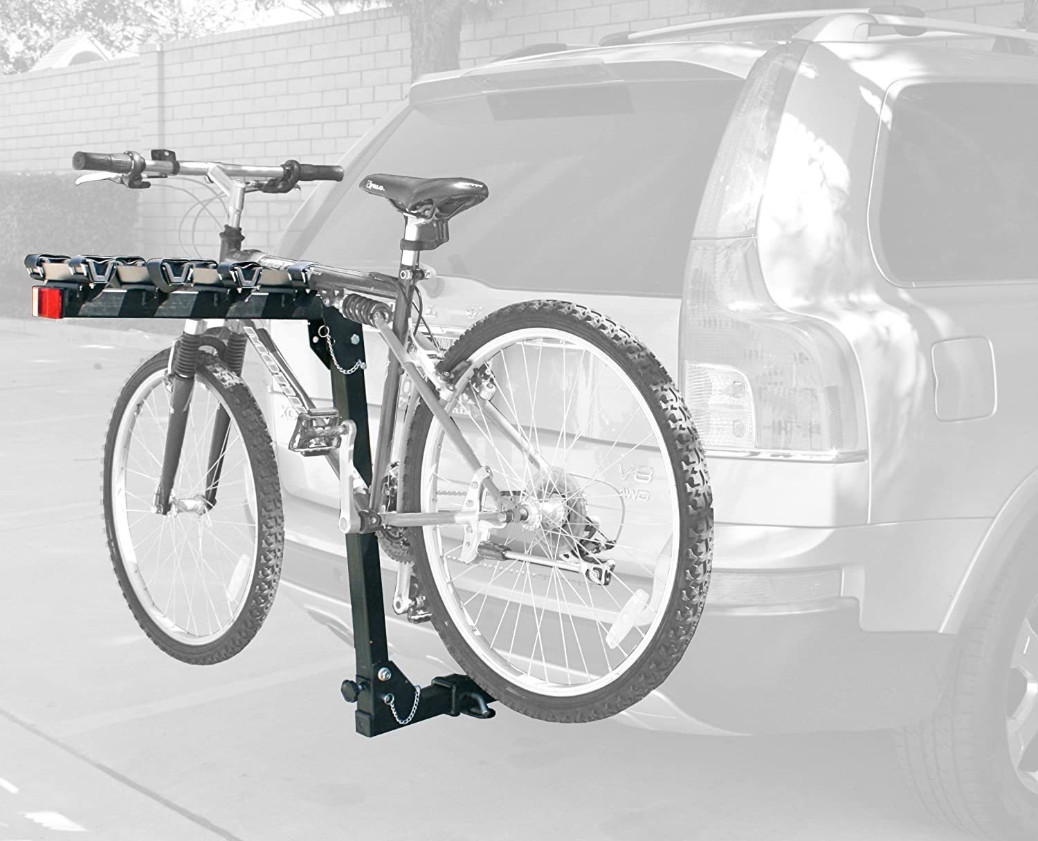 Image of a bike loaded into a bike rack that is mounted on a car's back part.