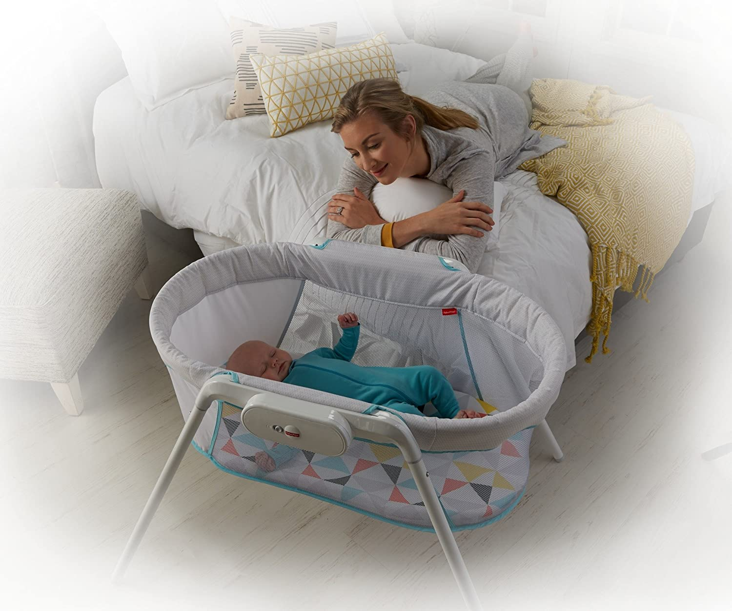 4. Fisher-Price Stow 'N Go Bassinet