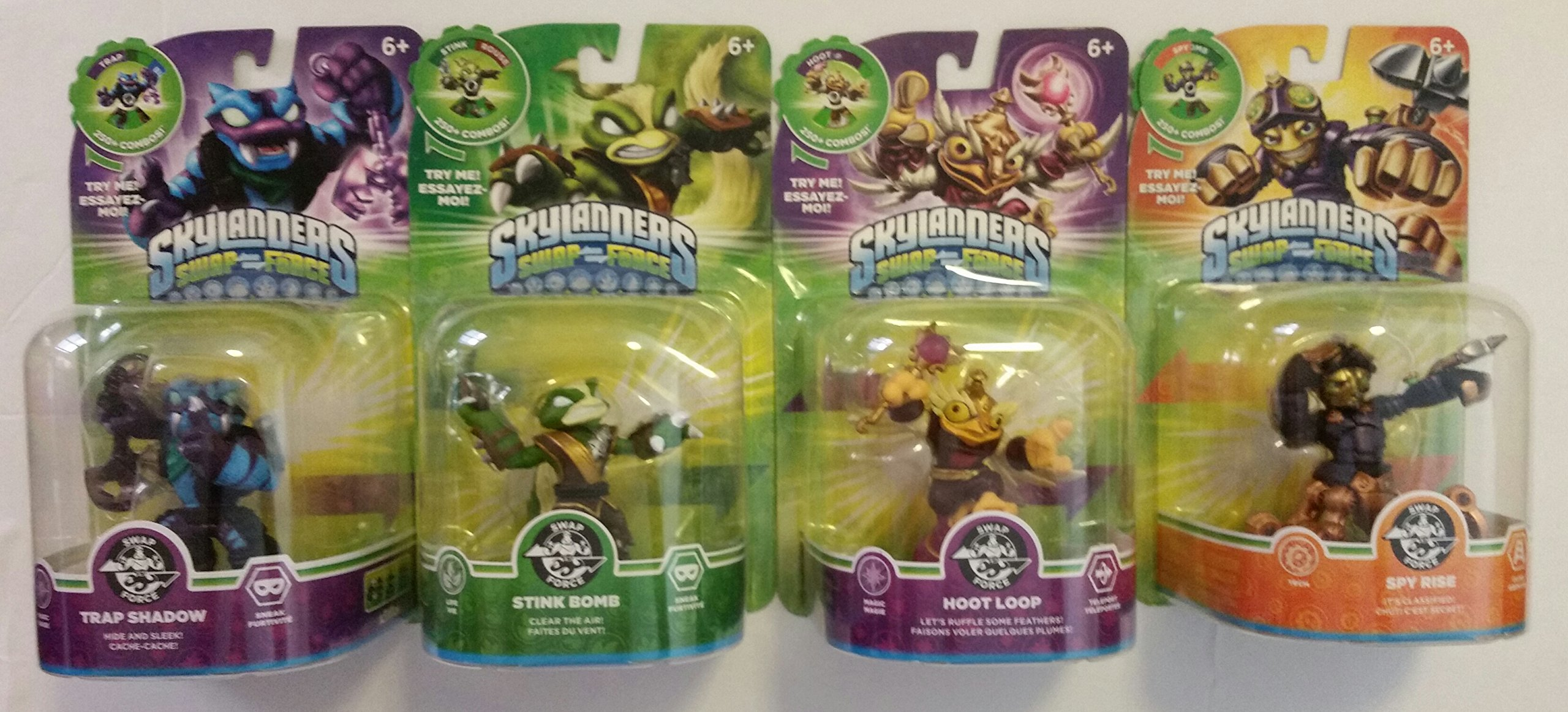 Skylanders Swap Force Action Figures (4) : Spy Rise , Hoot Loop , Stink Bomb , and Trap Shadow