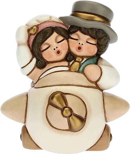 THUN-Coppia sposini abbracciati con Bouquet