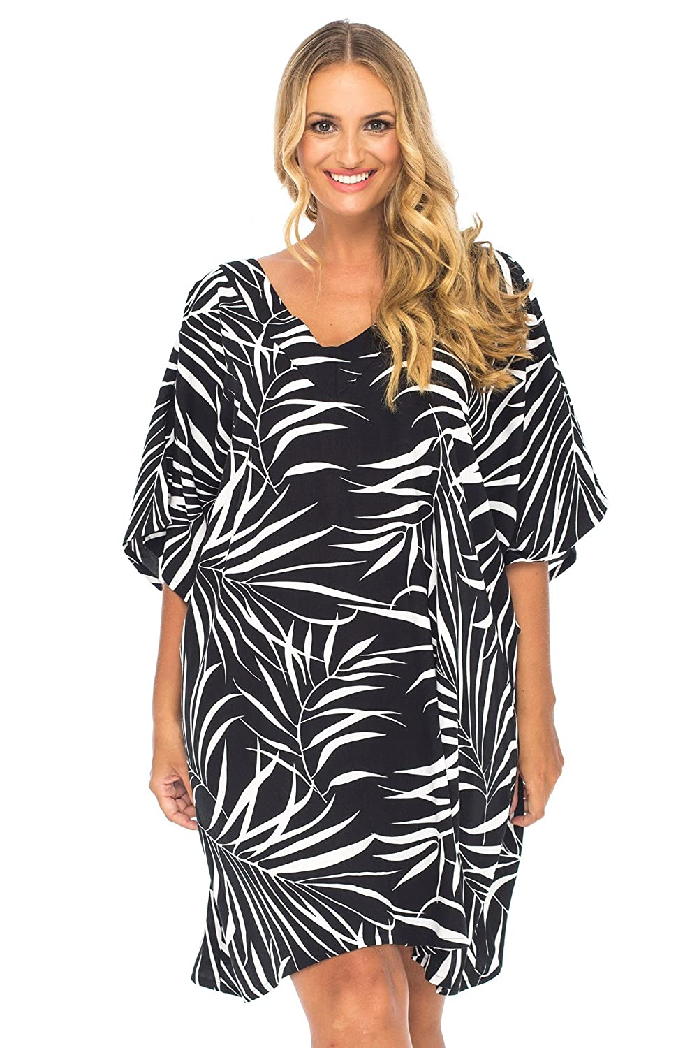 e2c59375a72580 Gorgeous Back From Bali plus size sundress poncho in a striking black and  white palm frond print adds tropical allure at the beach or as a tunic dress