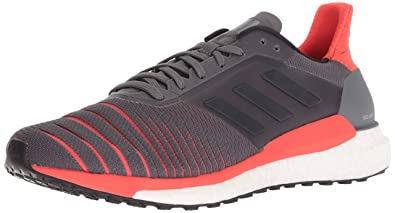 new concept c166d ff202 adidas Men s Solar Glide Running Shoe, Grey Black hi-res red,