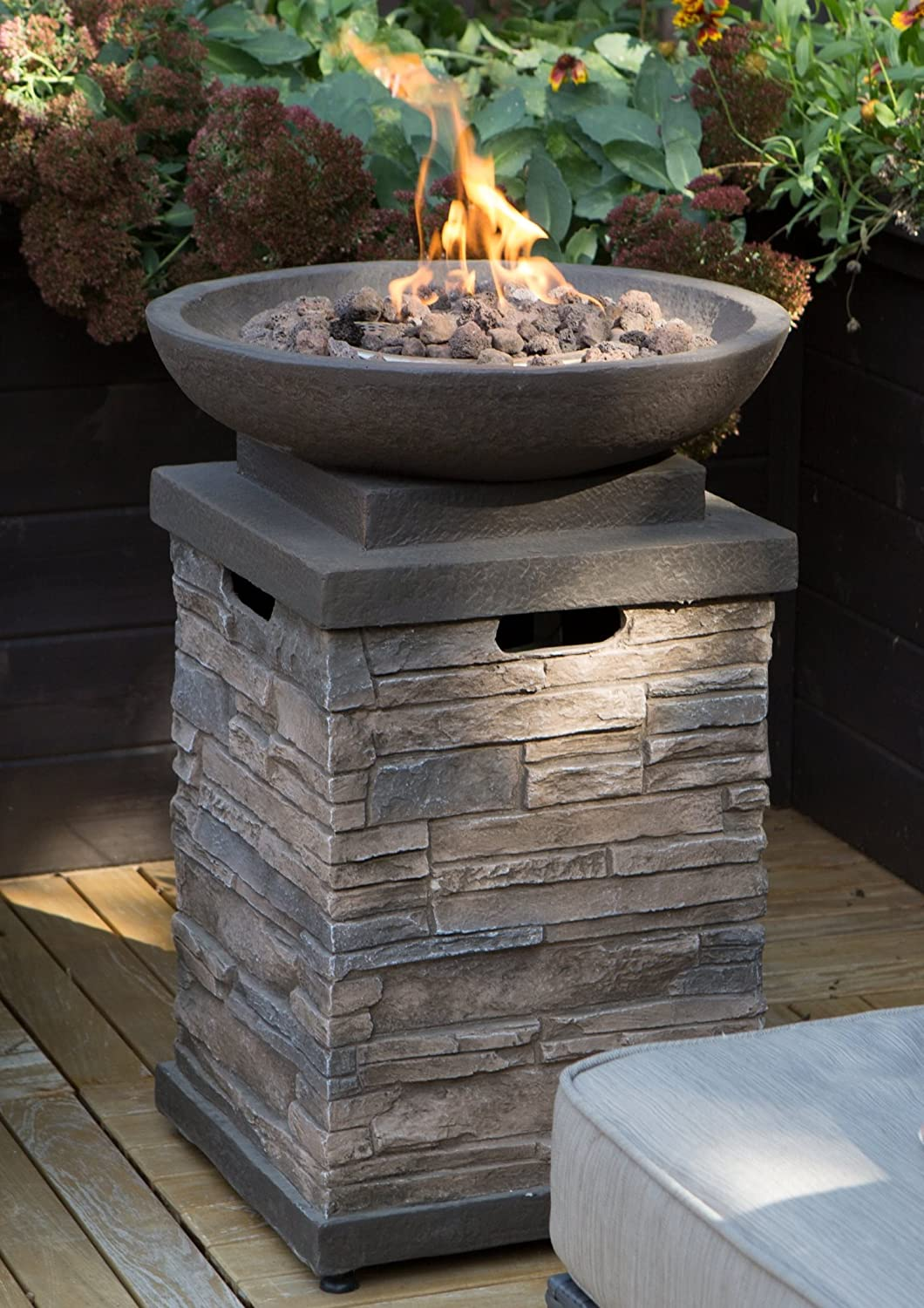 Realistic Stone-like Outdoor Patio Fire Pit Bowl with Free Cover. Get Ready for Entertainment in Your Backyard or Deck. This 30,000 BTU Propane Firepit Bowl Has Hideaway Storage for a 20lb Propane Tank and Also Comes with Clean Burning Lava Rocks