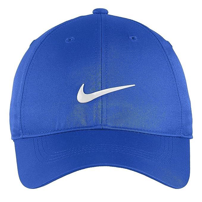 big sale d9239 6a38c Amazon.com  Nike Authentic Dri-FIT Low Profile Swoosh Front Adjustable Cap  - Black  Clothing
