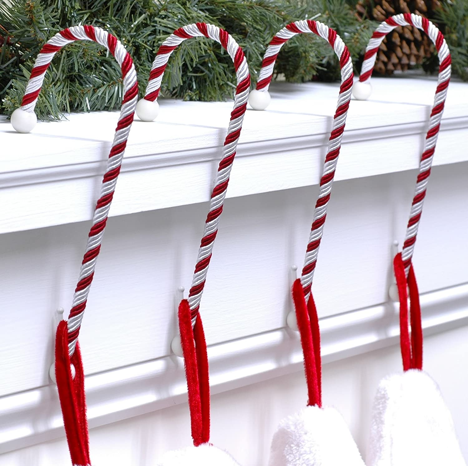 amazoncom haute decor cc0402r candy cane stocking holder 4 pack classic red and white home kitchen - Christmas Stocking Holders For Fireplace