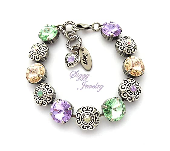 ec511d515ff Image Unavailable. Image not available for. Color: Swarovski® Crystal  Flower Bracelet, 12mm Rivoli ...