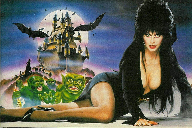 Amazon Com Gryd Elvira Mistress Of The Dark Atari Sign Metal Tin Sign Film Movie Vintage Retro Tin Sign Metal Sign Tin Sign 7 8x11 8 Inch Home Kitchen