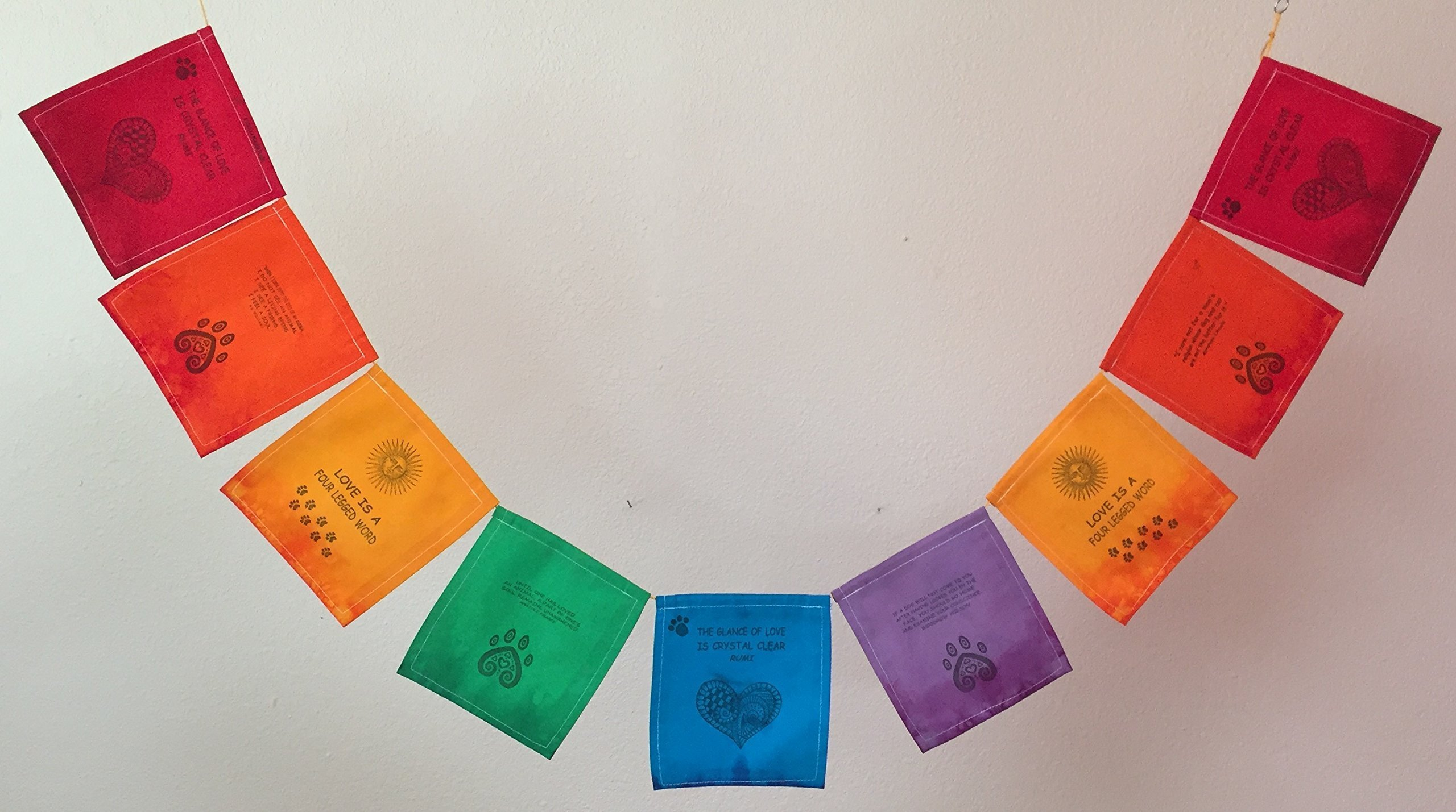Love is a Four-Legged Word, a prayer flag honoring our faithful and loving dogs and cats.