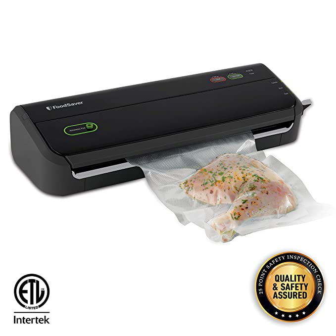 FoodSaver FM2000 Vacuum Sealer Machine with Starter Bags & Rolls | Safety Certified | Black