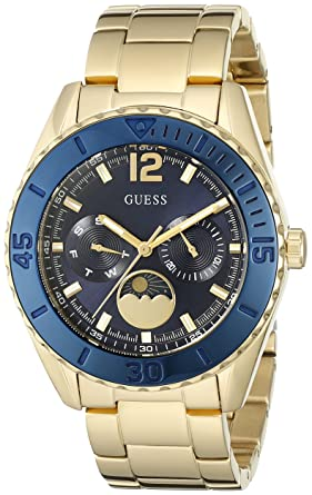 GUESS Womens U0565L4 Gold-Tone Multi-Function Watch with Iconic Blue Moonphase Dial