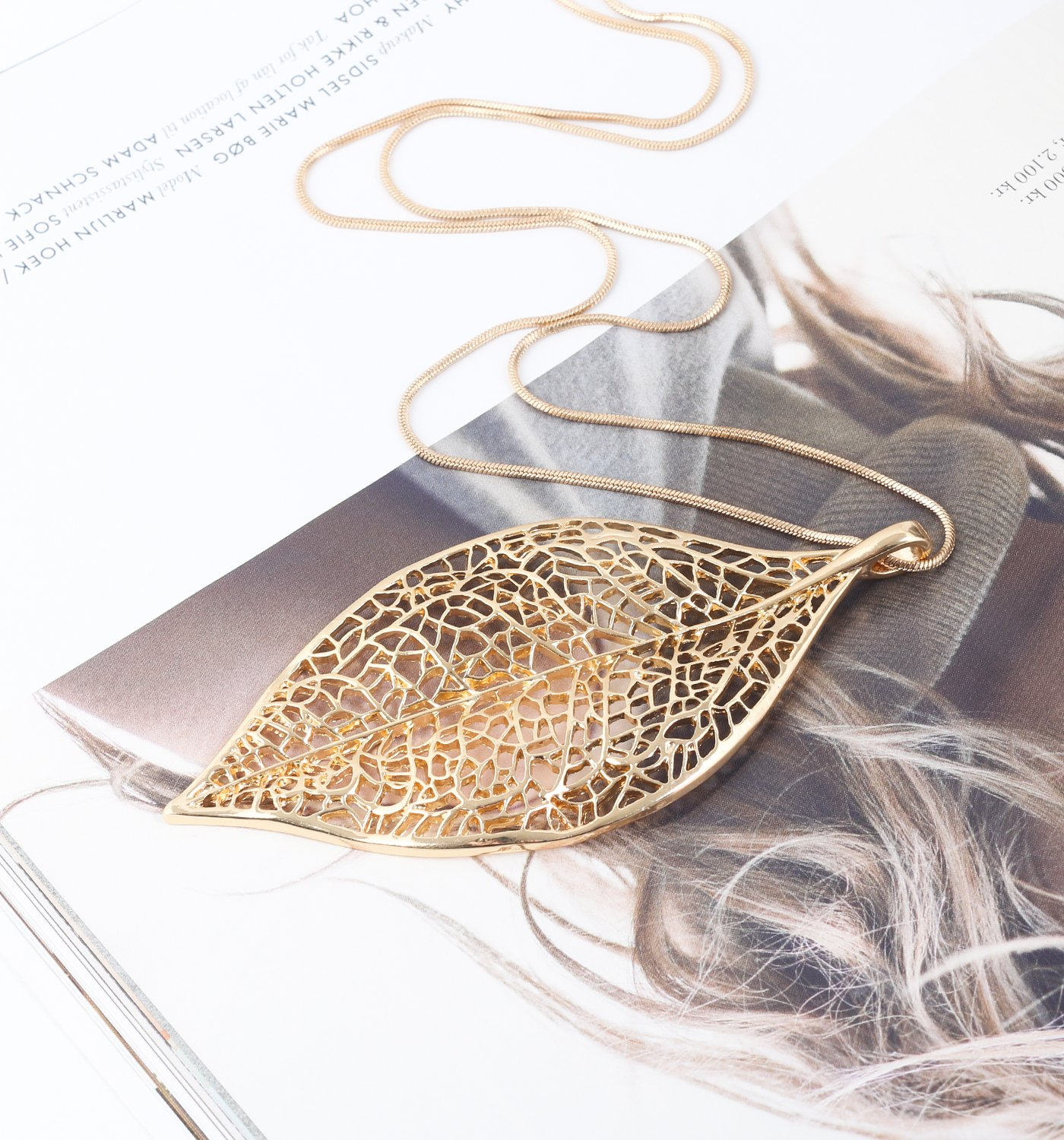 NLCAC Filigree Leaf Pedant Necklace Snake Chain Gorgeous Hollow Leaf Necklace Bohemian Jewelry for Women, Girls (Gold Tone)