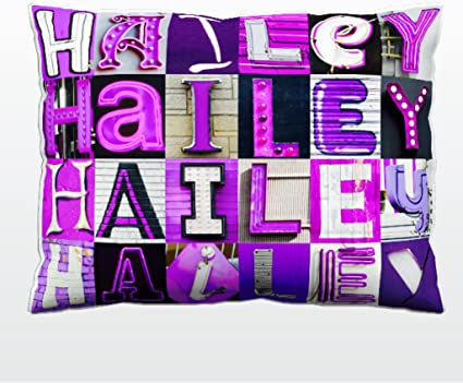 Personalized Pillow featuring the name TREVOR in photos of actual sign letters