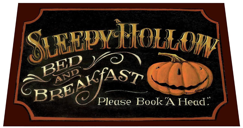 The Sleepy Hollow design by folk artist Jami Boldy is featured on this door mat