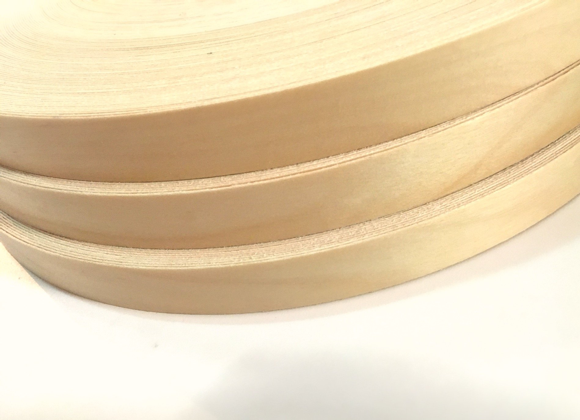 Maple Pre-finished 7/8'' X 500' Automatic (Non Glued) Wood Veneer Edgebanding. Clear UV Laquer Finish. Made in USA.
