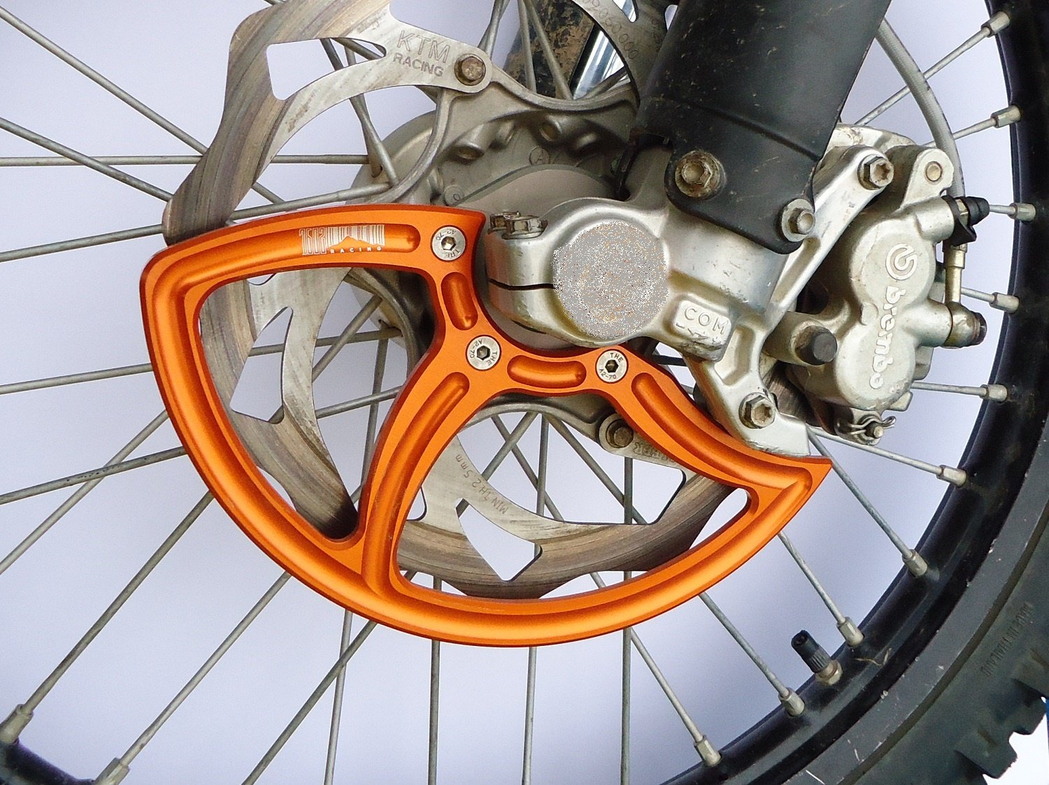 7602 Racing front disc guard. KTM / Husqvarna. 26mm front axle. orange