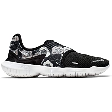 online store 99ac2 740c9 Amazon.com   Nike Women s Free RN Flyknit 3.0 FLR Running Shoe Black White  Size 6.5 M US   Road Running