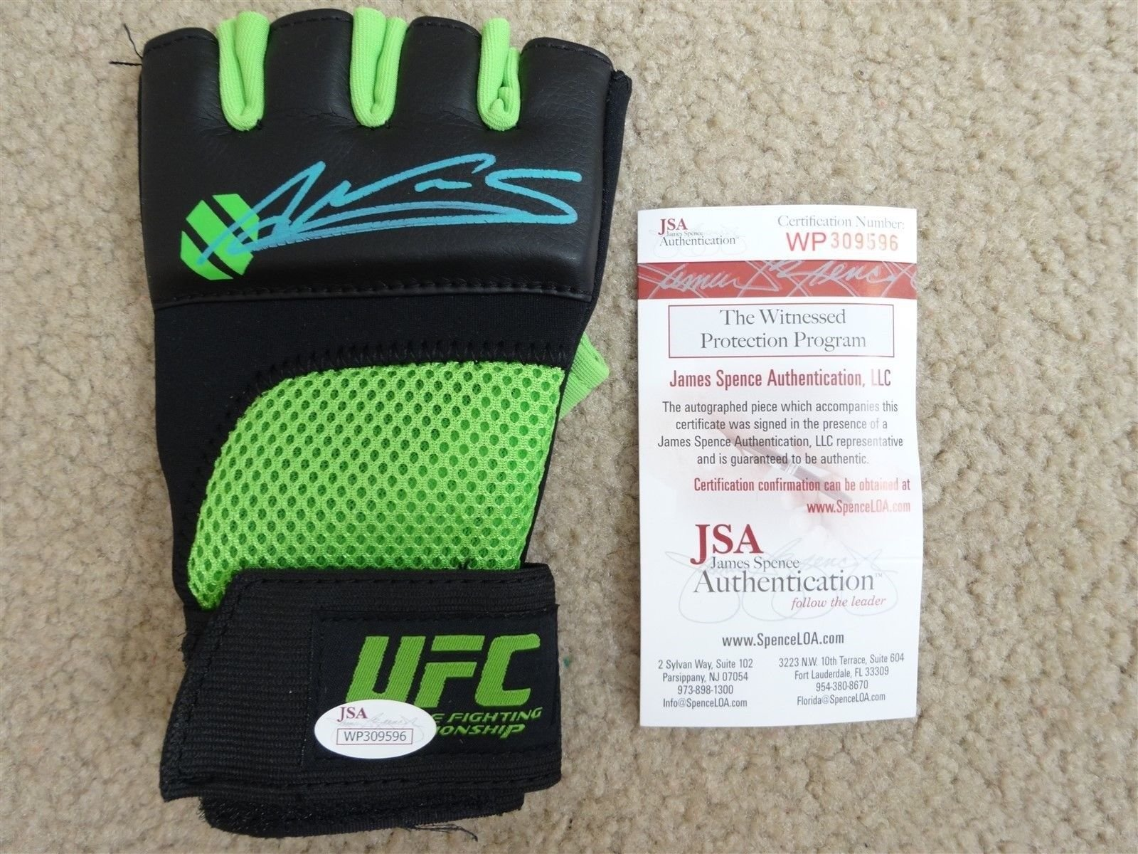AMANDA NUNES SIGNED AUTO GREEN AND BLACK UFC FIGHT GLOVE JSA AUTOGRAPHED