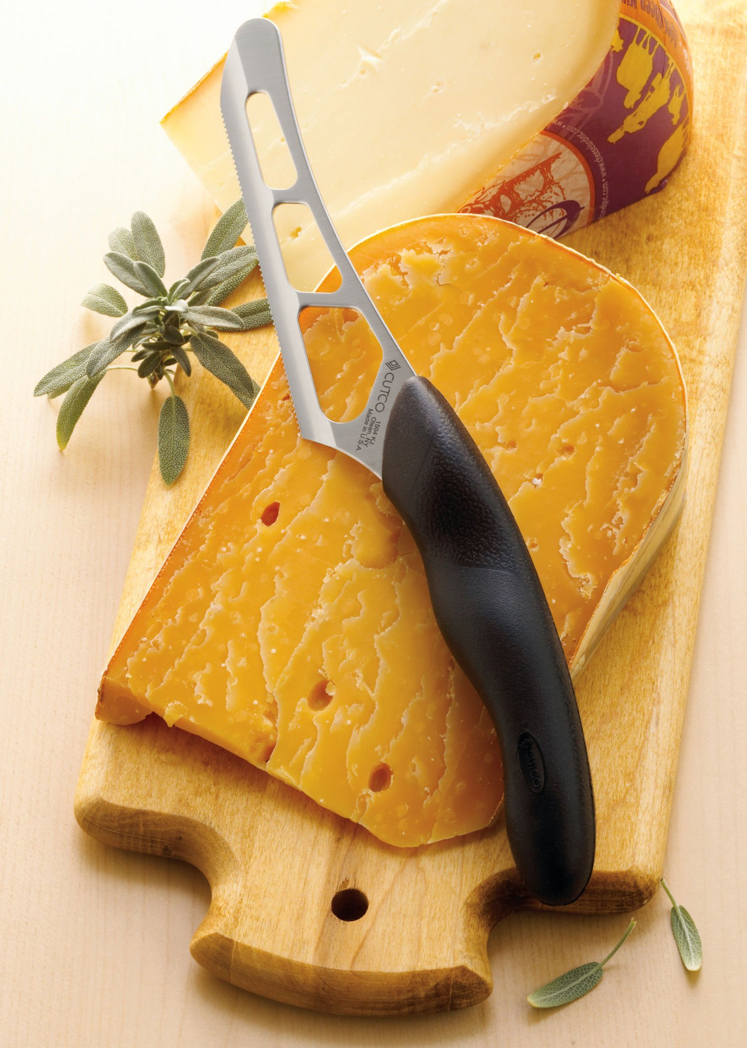 CUTCO Model 1504 soft handle Cheese Knife --- 5.5'' stainless blade & 5'' black handle.