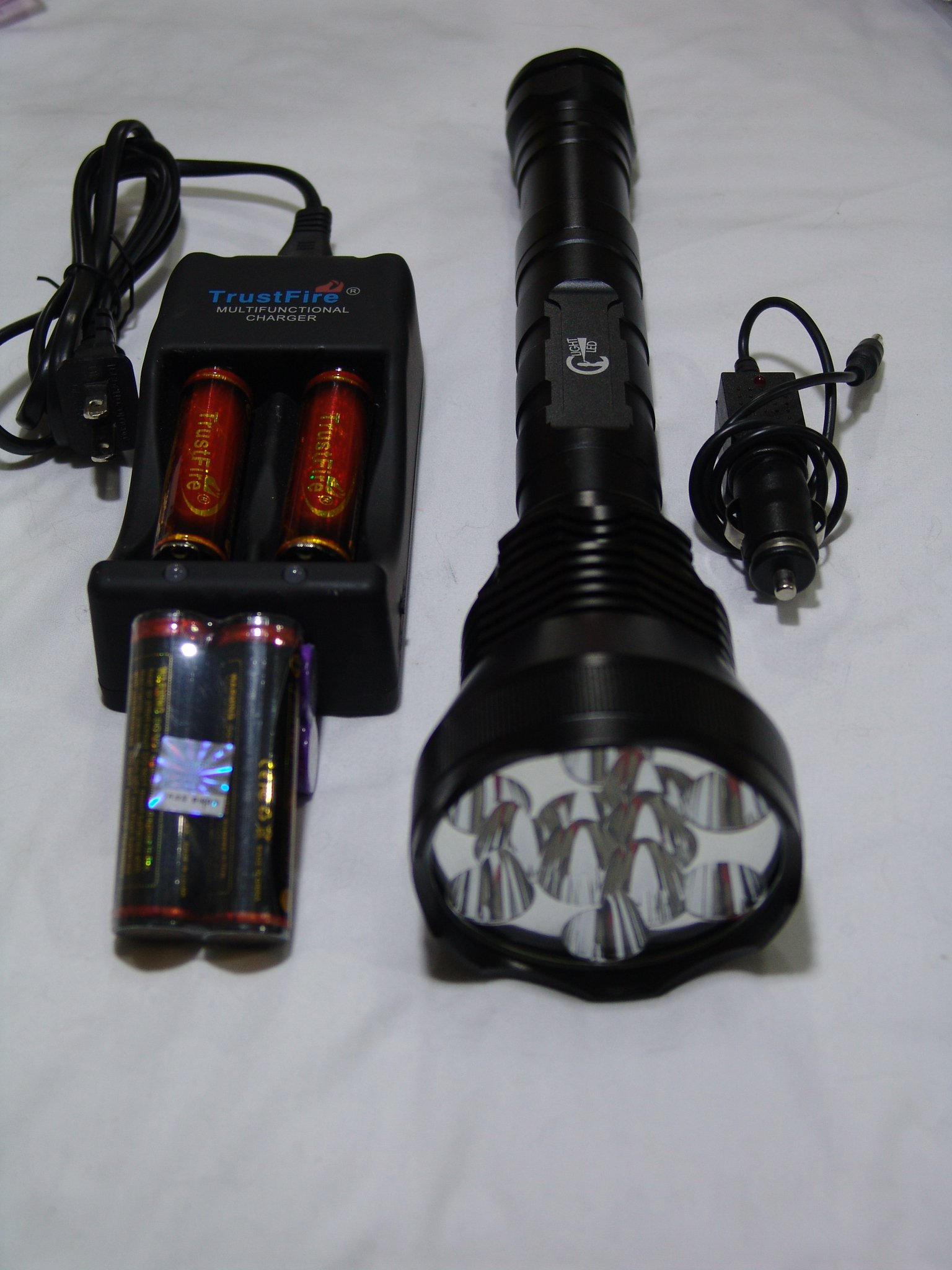 Mouse over image to zoom Have one to sell? Sell it yourself Details about C Light LED 12X Cree T6 13,000 Lumen Flashlight + TrustFire 3X 18650 & 006 Smart Charger