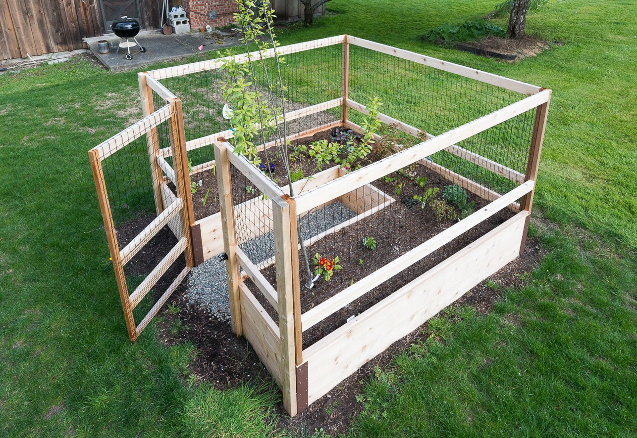 """Deer-Proof Just Add Lumber Vegetable Garden Kit - 8'x8' 3 DOES NOT INCLUDE LUMBER. Kit includes everything but the lumber: 8 Raised bed brackets, black nylon netting for fencing/trellis, black vinyl-coated steel wire for gate, ceramic-coated rust resistant screws, plus all other required hardware and detailed instructions Buy your own rough lumber locally - Build the ultimate vegetable garden with this kit. Required rough construction lumber : (10) 2""""x10""""x8'; (1) 2""""x10""""x6'; (6) 2""""x4""""x12'; (2) 2""""x4""""x8'; (3) 2""""x2""""x12'; (1) 2""""x2""""x8'; (4)1-5/8""""x1-5/8""""x12' (actual size). Note: the lumber boards will need to be further cut into the sizes described in the assembly instructions Gated garden keeps out deer, rabbits and dogs"""