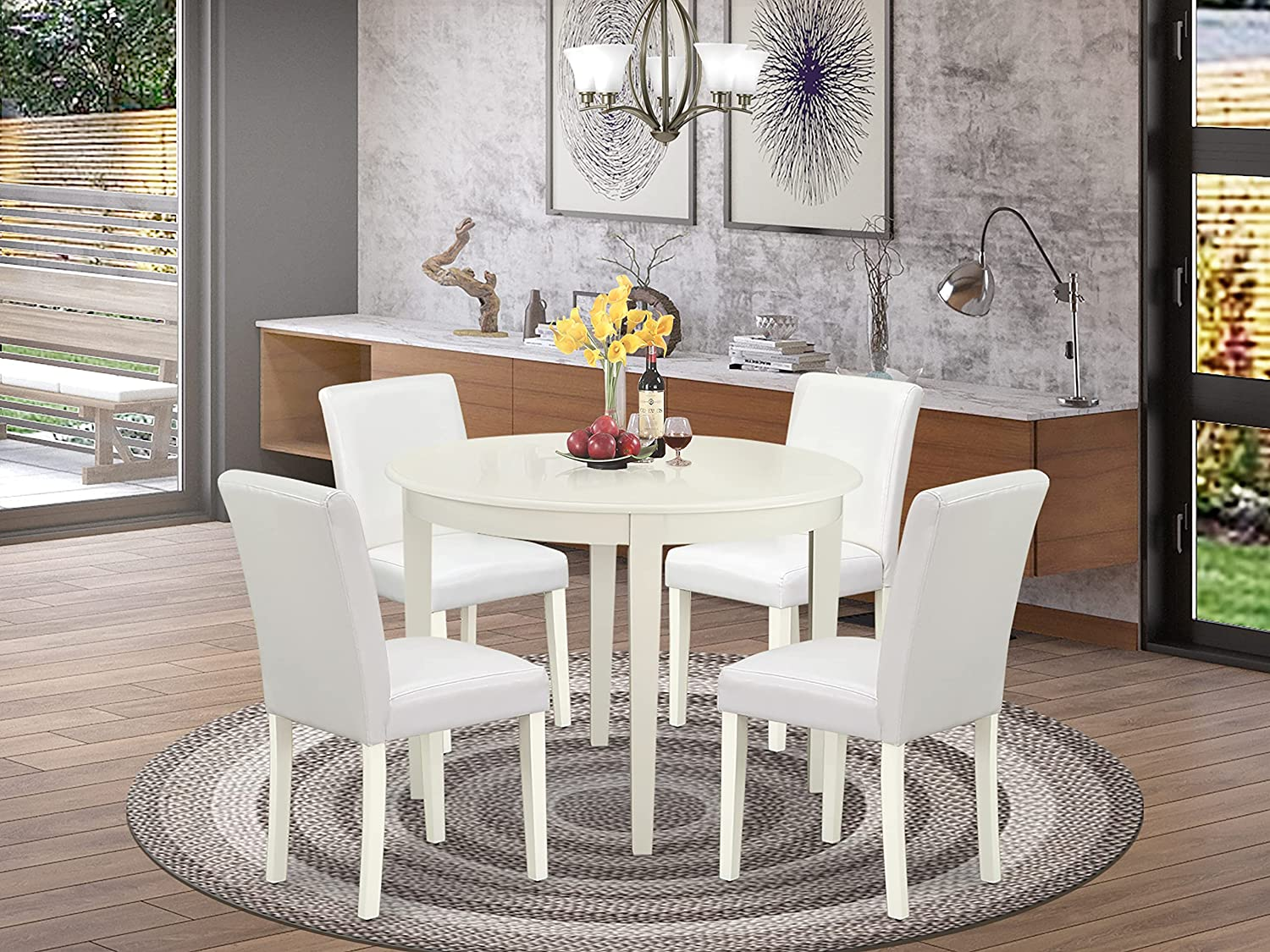East West Furniture Dining Set 5 Pieces - White PU Leather Kitchen Parson Chairs - Linen White Finish 4 legs Hardwood Round Dinner Table and Frame