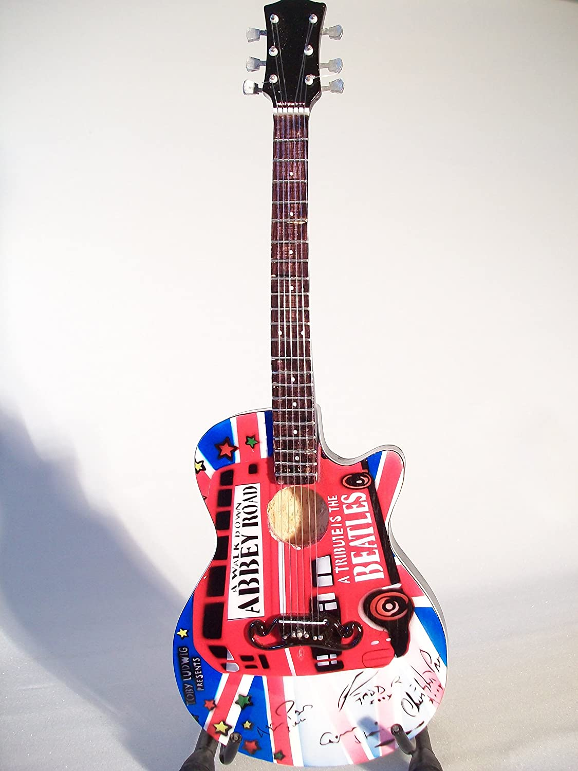 Mini guitarra de colección - Replica mini guitar - The Beatles - Tribute - Abbey Road - TOP SELLER: Amazon.es: Juguetes y juegos