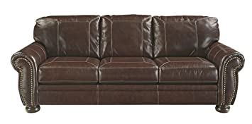 Ashley Furniture Signature Design Banner Traditional Style Faux Leather Sofa With Nailhead Trim Coffee