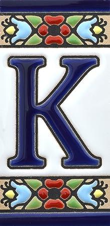 """Image of Letreros con numeros y letras en azulejo de ceramica, pintados a mano en técnica cuerda seca para nombres y direcciones. Texto personalizable. Diseño FLORES MINI 7,3 cm x 3,5 cm. (LETRA """"K"""")"""