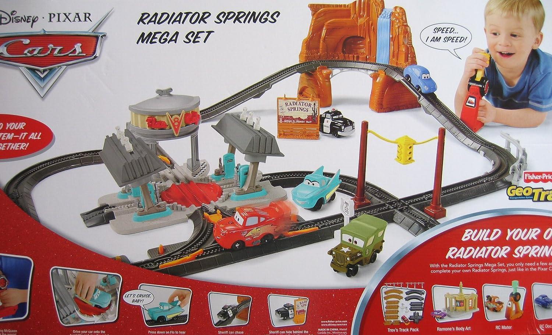 Amazon com disney cars geo trax radiator springs mega race set w turbo remote control sounds 5 cars 2009 toys games