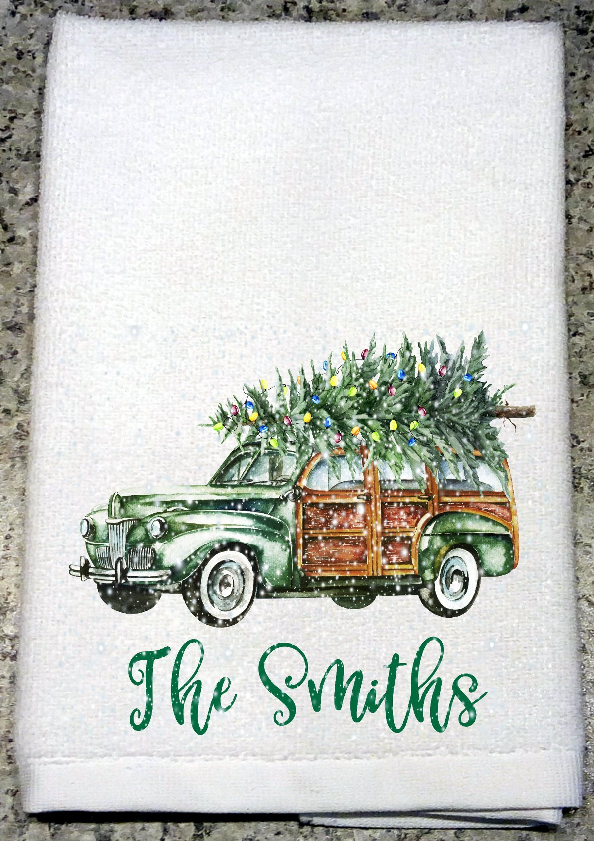 Vintage Woody Station Wagon with a Lighted Tree on Roof in Falling Snow with Phrase Kitchen Towel