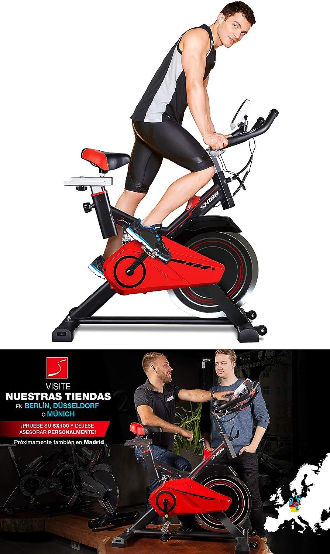 Sportstech SX100 Bicicleta Indoor; Volante de inercia 13kg; reposabrazos Acolchados, Asiento cómodo, pulsometro, Sistema de transmisión por Correa y Motor silencioso - con Kinomap & eBook Gratis: Amazon.es: Deportes y aire libre