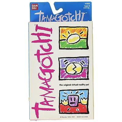 Original V1 1996/1997 Tamagotchi Gold Virtual Reality Pet by Bandai: Toys & Games