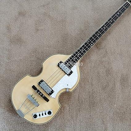 Guitarra de 4 cuerdas, color blanco crema, parte superior con ...