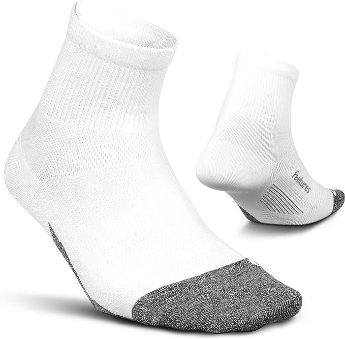 A pair of Feetures Unisex Elite Ultra Light Quarter Sock, white color.