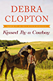 Kissed by a Cowboy (A Four of Hearts Ranch Romance Book 3)
