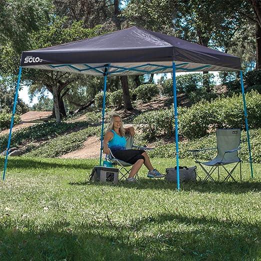 Cenador plegable ultra compacto de aluminio Quik Shade- SOLO. 90 l. 3,7 × 3,7 m. Gris oscuro/azul.: Amazon.es: Deportes y aire libre