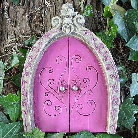 Prezents.com - Figura decorativa para jardín de árboles, diseño de duende, color rosa: Amazon.es: Hogar