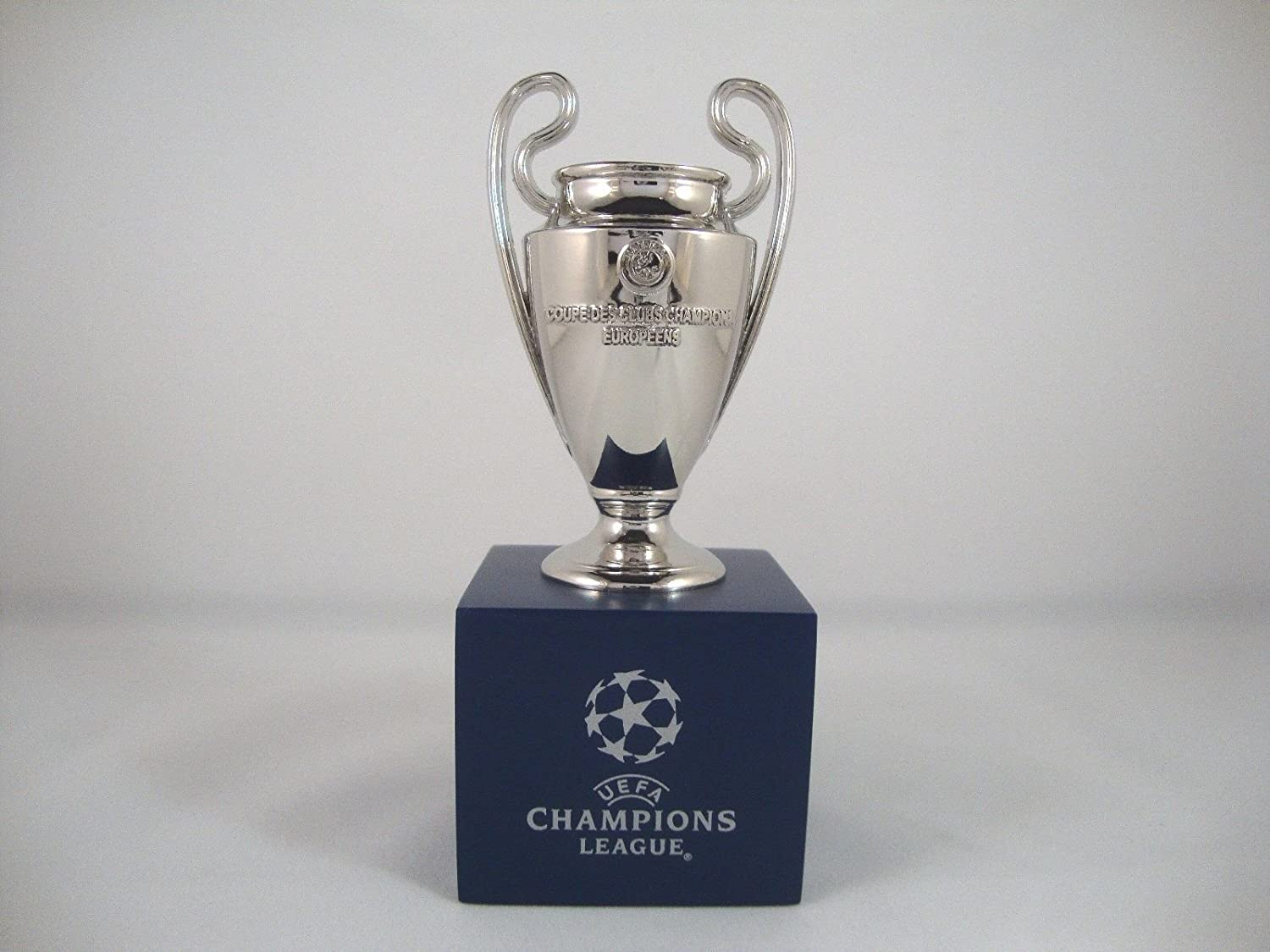 uefa champions league trophy 70mm footed cup amazon co uk sports outdoors uefa champions league trophy 70mm footed cup