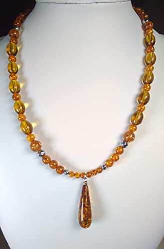 6db82d0d2170 Precious Modernist Amber crystal necklace with Copal Amber beads and Topaz  Citrine coloured nuggets plus free ear rings  Amazon.co.uk  Handmade