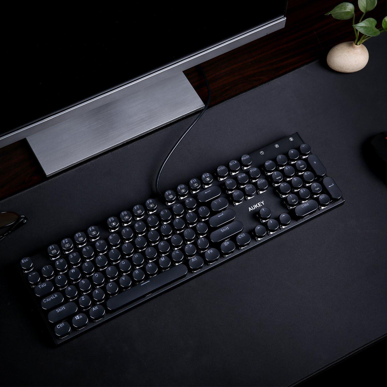 AUKEY Teclado mecánico con interruptores Azules, Teclado Tipo máquina de Escribir de 104 Teclas para mecanografía y Juegos