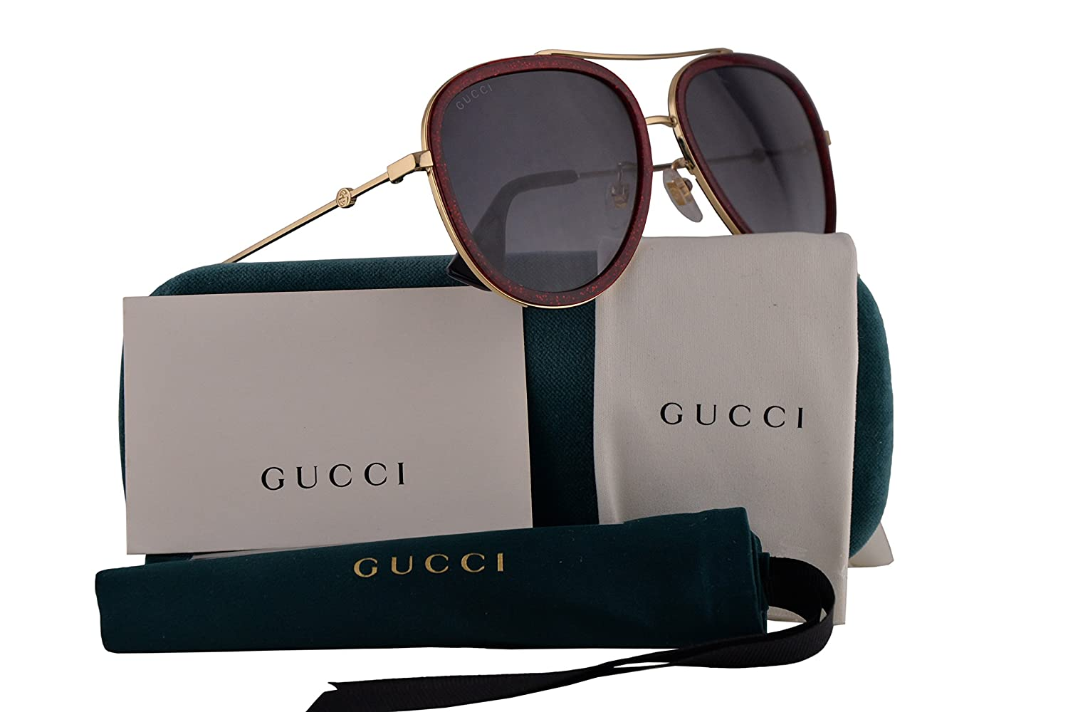 ce4b5ba1968 Gucci GG0062S Sunglasses Red Gold w Blue Gradient Lens 005 GG 0062S  Amazon. ca  Clothing   Accessories
