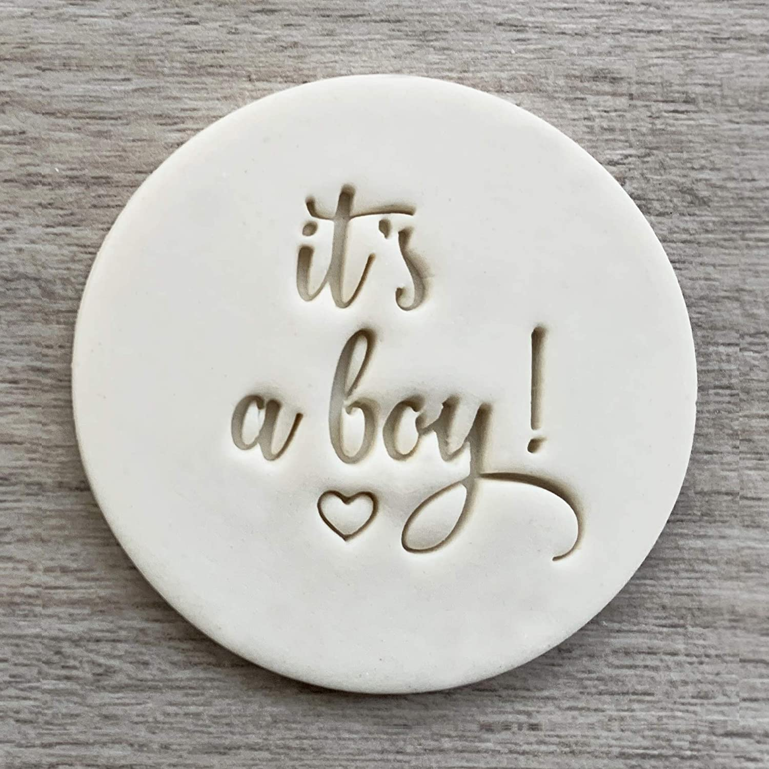 It's a boy Fondant Embosser or Cookie Stamp with handle