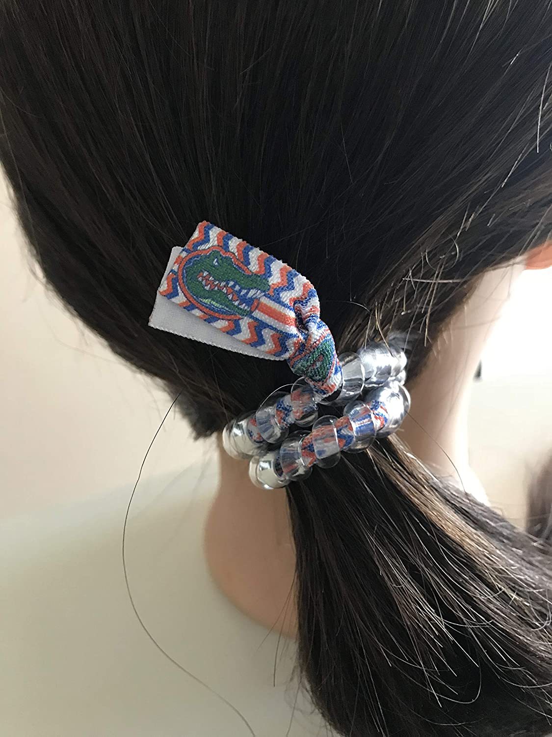 Denver Broncos football Secure sports hair tie hair cord hair elastic for all pony tail types messy buns.